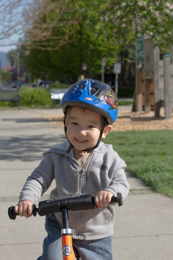 Joshua demands that I take his pictures when he rides his bike.