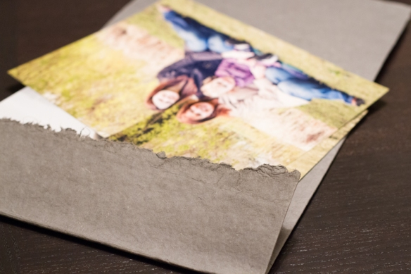 Here you can see the torn edge of the handmade paper.  I love little details like that.