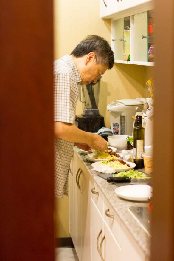 My dad preparing another feast in the kitchen.