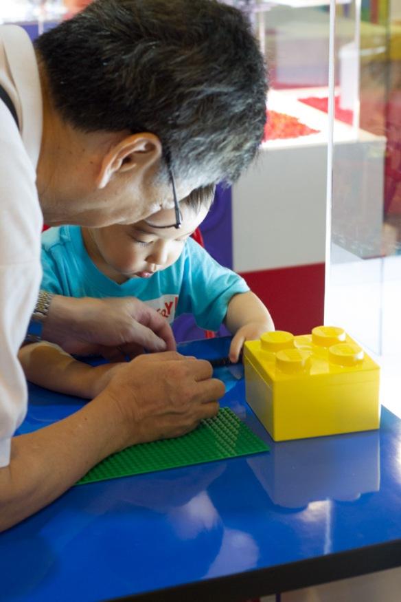 Gong-gong playing Lego with Joshua.
