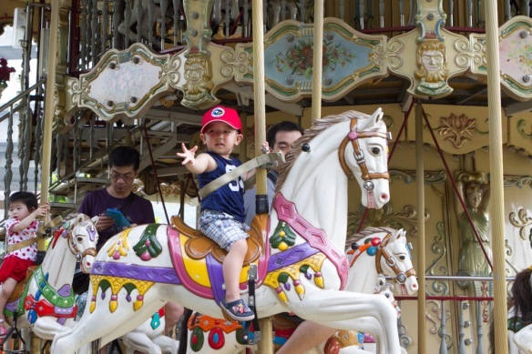 The same carousel I was addicted to at Joshua's age.