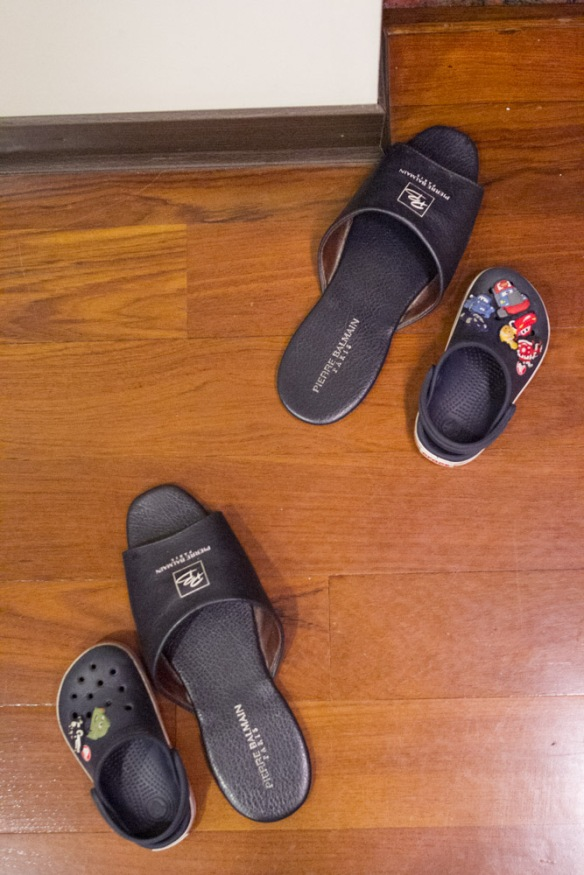 Joshua likes to put his shoes next to my dad's slippers, even when the slippers are apart.
