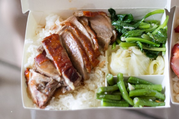 Road side bento box of BBQ duck and rice. C$2.