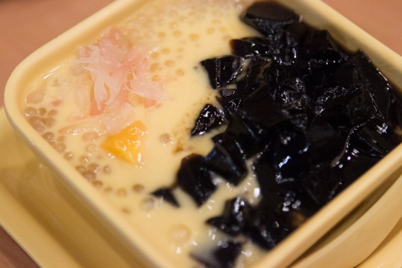 Grass jelly, mango, and tapioca dessert.