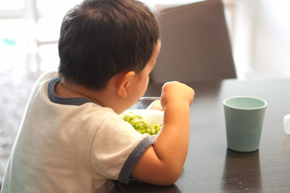 My picky eater chowing down the green mac and cheese!