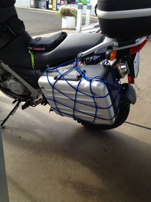 Fiona's luggage got a little beaten up on the trip. A little bungee net to help it hang on.