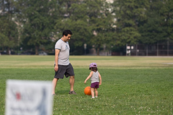 Playing soccer with Daddy.